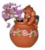 Exclusivelane Brown Terracotta Hand Painted Baby Ganesha Crawling on The Matki